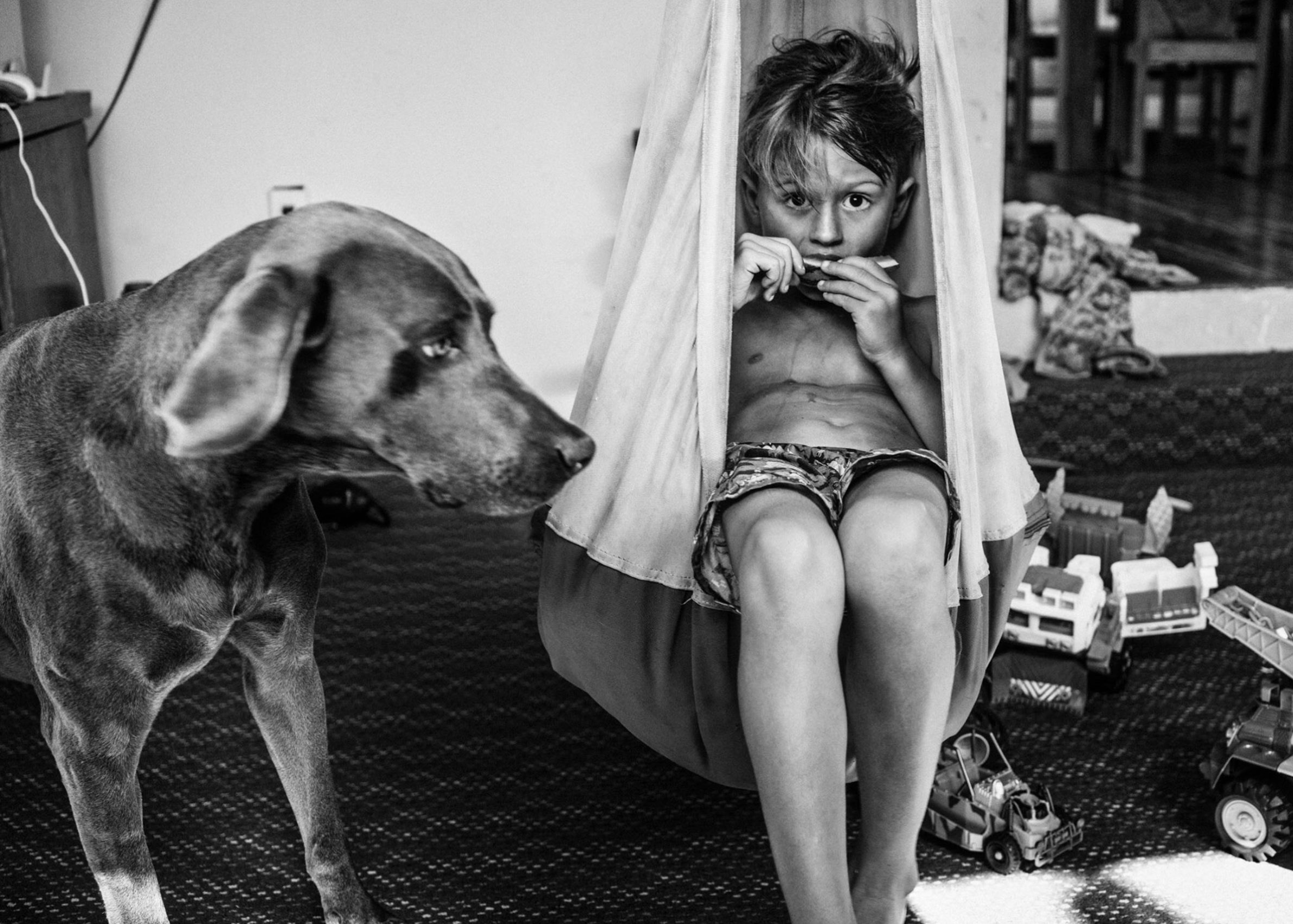 Los Angeles Street Photographer - Boy and his dog by Ray Kachatorian