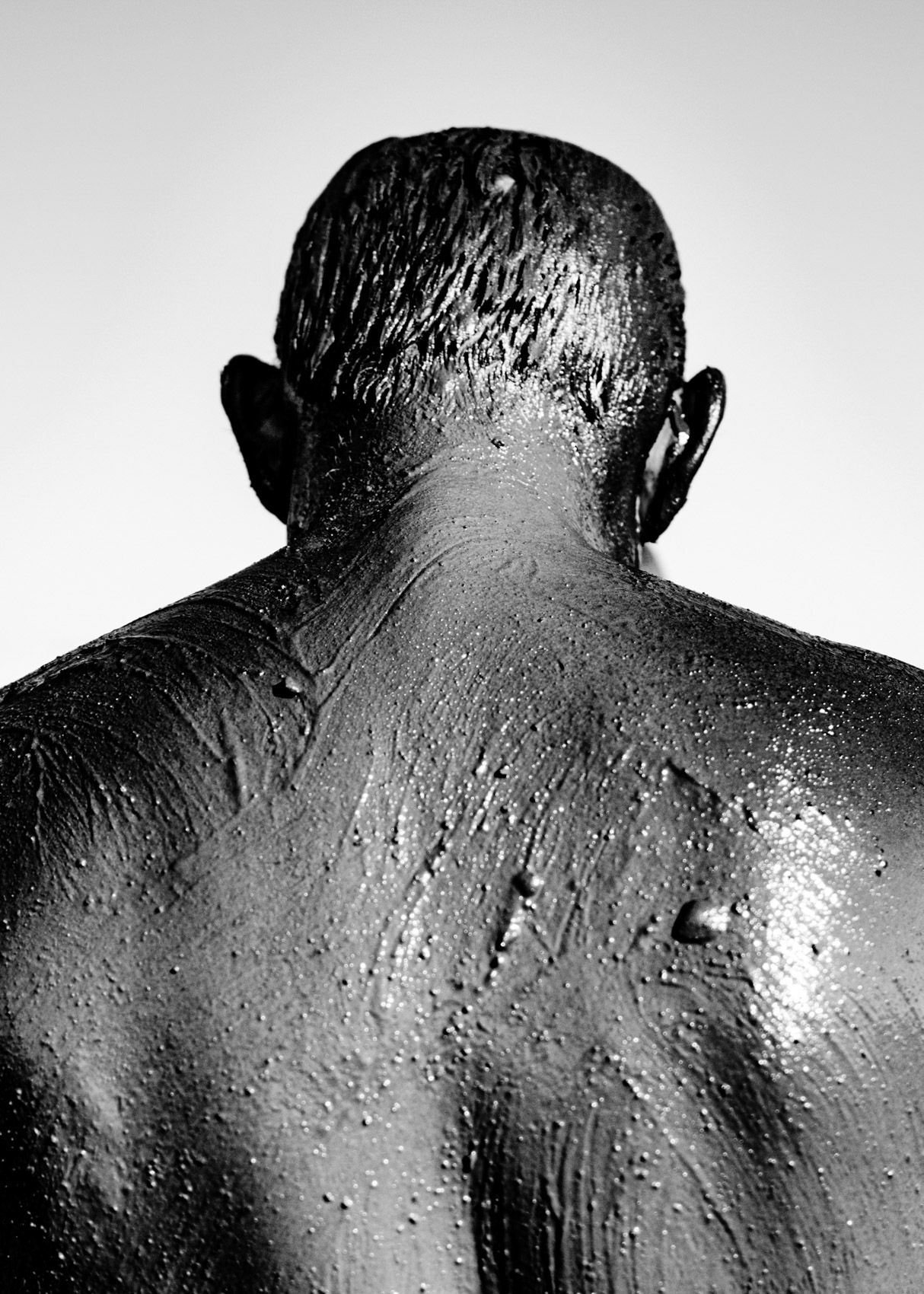 Los Angeles Street Photographer - Man in covered in Dead Sea Mud Israel by Ray Kachatorian